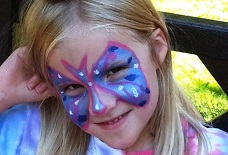 Student with butterfly face paint