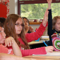 Elementary students raising hands
